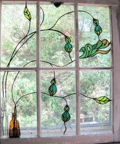 Beautiful stained glass window- Would love something this simple and beautiful- maybe with a bee and flowers for my kitchen window. #StainedGlasses