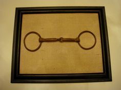 Beautiful handcrafted framed vintage chain horse bit offered in a contemporary interpretation of rustic equestrian décor. Distressed vintage horse