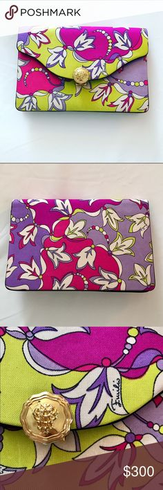 Vintage Emilio Pucci silk clutch pink purple green What a beauty!  This vintage Pucci bag is in excellent condition.  Silk fabric in bright and beautiful colors of fuchsia, purple, green and white.  Organic leaf floral print.  Emilio written through out the fabric.  Envelope style with gold flip button clasp.  Black satin interior. 7.5 x 5 Emilio Pucci Bags Clutches & Wristlets