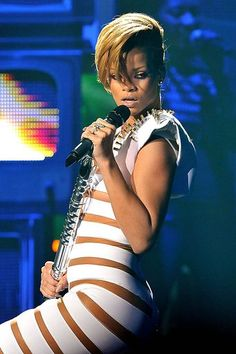 Lester Cohen/WireImage 2009 Rihanna performs onstage at the 2009 American Music Awards at Nokia Theatre L.A. Live on November 22, 2009 in Los Angeles, California.