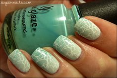 Sweet Sugar did a Gradient of OPI My Boyfriend Scales Walls and China Glaze For Audrey, then a thin coat of China Glaze Wireless, then stamped with Konad plate m70 and Konad white polish.