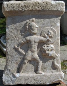 An ancient marble altar dating to the second century and showing a nude warrior battling a serpent monster has been discovered by villagers near the Akçay River in Turkey.