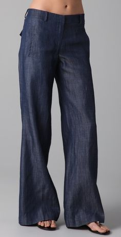 Low-rise Chambray Wide-leg Jeans.. Would look super cute with a gray or white wife beater. I can't wait to get rid of the skinny jean craze!
