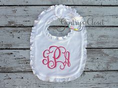 Monogrammed White Ruffle Bib   Gentry's Closet   $15   Click link to shop: http://gentryscloset.com/collections/burp-cloths-and-bibs/products/monogrammed-ruffle-bib