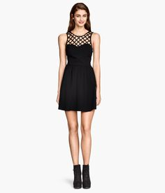 Short black sleeveless dress with net-patterned yoke, low cut V-neck back, and gently flared skirt. | Party in H&M