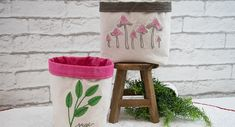 Embroidered fabric baskets are great way to organize and decorate at the same time! Use them to hold small potted herbs, sewing notions, breakfast bars, or used as a goody bag filled with fresh fruit snacks and magazines for a sick friend. The options are truly limitless. #DIY #fabric #bin #basket #bucket #tutorial