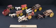 HANDPAINTED HORSE AND BUGGY TOY MODELS MADE OF CAST IRON. THEY COME IN VARIOUS SIZES, ABOUT 3 INCHES TO 5 INCHES LONG. SOME ARE ANTIQUE AND SOME ARE REPRODUCTIONS. THIS LOT ALSO INCLUDES A CERAMIC WELLS FARGO BANK BUGGY.