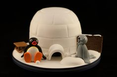As a kid I loved watching Pingu so was chuffed to be asked to make a Pingu cake. A very simple design but the characters had to be spot on! The birthday message was subtly embossed onto a little snow-topped wooden sign, sweet!