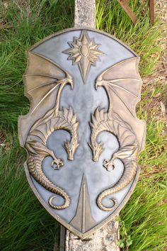 I love the faded metal colours of this shield! The dragons are cool, but not over stated and the sun sigyl at the top just seals the deal. This is such a gorgeous larp shield.  ---  Epic Dragon Knights shield. Larp safe