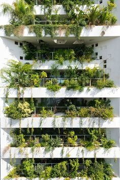 """To suit Cyprus' Mediterranean climate, Ateliers Jean Nouvel designed the building around what it describes as a """"natural brise soleil"""" – a facade where numerous openings are infilled with plants. Architecture Durable, Nature Architecture, Concept Architecture, Futuristic Architecture, Facade Architecture, Sustainable Architecture, Sustainable Design, Residential Architecture, Classical Architecture"""