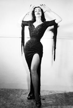 Vampira played by Maila Nurmi from the Vampira Show 1954. The Horror Hostess with the mostess who would build the black widow sexy vampire look.
