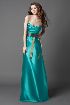 This rich and exotic copper and teal combination stars a full-length chiffon bridesmaid dress with a sweetheart neckline designed by Dessy. To offset the jewel-toned gown, I selected copper-hued accessories, including smoky quartz earrings and a Jimmy Choo clutch! This palette was inspired by a.