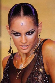 Clean and sleek hair with dramatic white and black winged eyes creates a striking look for Latin. Visit http://ballroomguide.com/comp/hair_make_up.html for more hair and makeup info