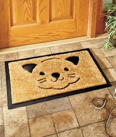 """Cat Coir Doormat . $21.99. Coir fibers trap dirt and mud. 17-1/2"""" x 29-1/4"""". Rubber backing. A cheerful way to greet guests!. Protect your floors from tracked-in dirt and other debris with a Pet Coir Doormat. It's a cute way to help your home stay cleaner. Nonskid rubber backing prevents slipping. 17-1/2"""" x 29-1/4"""". Imported."""