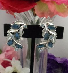 "25% off with Coupon Code 70417 Vintage Sarah Coventry Blue & Clear Large Rhinestone Earrings 1.25"" Set in Silvertone Free Shipping to the US this Weekend Only."