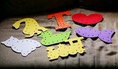 lacing cards made from sheets of foam cut into shapes and hole punched