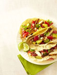 Talk about summery flavors: Sweet strawberries and creamy avocado make a luscious yet light topping for these chicken tacos. Click through for the recipe and more quick and easy summer dinner ideas.