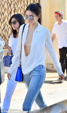 Kendall Jenner goes braless in daring plunging white shirt #dailymail