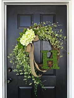 This is a very elegant and stately wreath with cascading flowers in various shades of green along with burlap bow and moss covered monogram. Perfect for very large doors or simply for making a statement of elegance and welcome to all who pass by it. :) Wreath base is 24 Letter measures 10 in height. Please specify the letter you would like as a note to the seller during checkout.