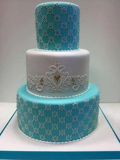 Absolutely stunning Tiffany blue wedding cake with an slight but exact detailed trellis design with gold beads inside the trellis.  Gorgeous cake.  ᘡղbᘡ