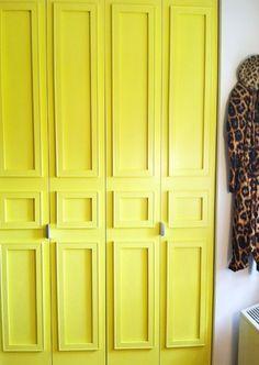 hmmmmm.... lovely...  Bi-Fold Doors Painted a Vibrant Yellow