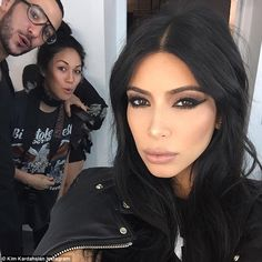 She's got the look: Kim, who is such a fan of taking selfies, she released a book full of them, called Selfish, posted a close-up shot of her made-up face as she draped an edgy leather jacket over her shoulders