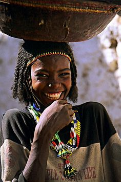 Africa |  Sights and Sounds  Harari smile.  East Ethiopia. The laughter totally brightens the photo. Beautiful caught-in-the-moment image.
