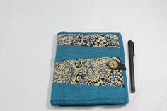 A blue-cotton-and-kalamkari covered diary with a pocket and handstitched tasselled bookmark inside