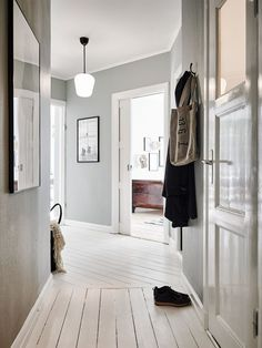 Struggling to decorate your long, narrow hallway? We have 19 long narrow hallway ideas that range in difficulty. From painting one wall to adding a long runner, we've got you covered. Turn your hallway into a library, or add shoe storage. Interior Inspiration, Room Inspiration, Interior Ideas, Hallway Ideas Entrance Narrow, Narrow Hallways, Modern Hallway, Bright Hallway, Upstairs Hallway, Entry Hallway
