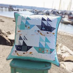 The free pattern can be found here. I've changed it up a bit and am doing scrappy sailboats. So the 2 1/2 X 4 1/2 print on the bottom of the sailboat I did 2 1/2 inch squares to keep with the scrappy look. Also for fun I'm using the cute Mendocino, Swimming Sisters and Swim Class for the bottom strips.
