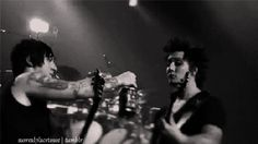 Avenged Sevenfold GIF . Synyster Gates drinking alcohol from his best guitar bud Zacky V.