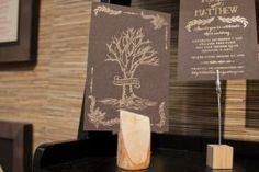 A rustic invitation printed by AR-EN Party Printers has a letter-pressed wood grain pattern.