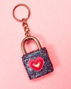 Using a glittery padlock for securing your luggage while traveling would look super cute, attractive, and gorgeous, isn't that so? You can even use it to keep your secret diary safe. I even attached a key ring to it and that looks super cool, right? #glitter #glittercrafts #sparkle #sparkles #sparklecrafts #padlock #diy #diypadlock #cutecrafts #glitters #crafting #craftideas #diysparkle #glitterprojects #keychain #glitterkeychain #glitterkeychains #padlockkeychain #sparklekeychain