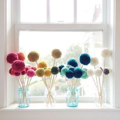 Pom Petals Are you horrible at keeping your flowers alive? Fill your vases with pom poms instead!