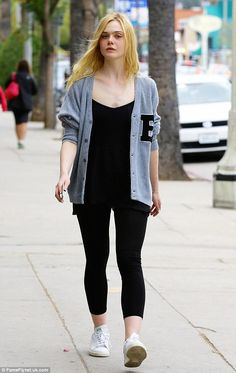 Stylish arrival: The actress teamed her black leggings with a cosy and grey varsity sweate...