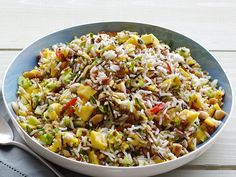 Great BBQ side dish! or any summer party.   Mango-Cucumber Rice Salad  This two-grain salad (it's made with quinoa and rice) depends on cukes for crunch and mango for some sweetness.