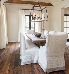 Linen chairs. Wood floors. Great light fixtures