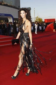Well, that's not the first thing I'd think to do with my old VCR tapes, but I guess this is one way to make an eco-friendly dress?
