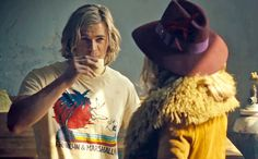 """[ew_image url=""""http://img2.timeinc.net/ew/i/2012/11/20/rush-01.jpg"""" credit="""""""" align=""""left""""]  Rush, the upcoming biopic about the rivalry between 1970s Formula 1 race car drivers James Hunt (Chris Hemsworth) and Niki Lauda (Daniel Brühl), may be about the need for speed, but the flirtation between Olivia Wilde as Suzy Miller and Hemsworth as charming Englishman Hunt will get hearts racing, too. The film, directed by Ron Howard, comes out in theaters on Sept. 20 and will be featured at the ..."""
