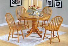 i really don't know how to describe this wooded round dining table with chairs set. It doesn't features retro design but seems like not suitable as modern furniture. Anyhow, it loos simple and nice.