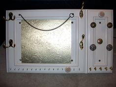 "Check it out Pinterest. I made this! It was an old kitchen cabinet sample and i added some ""junk"" i found around the house and turned it into a jewelry board!"