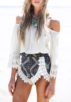 This off-shoulder two-piece shorts set comes with an off-shoulder top and a pair of printed shorts with crochet lace trimming. The top features an elastic off-shoulder neckline and bracelet sleeves while the shorts features multi-colored Aztec prints. | Lookbook Store What's New