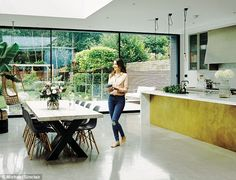 'I have a passion for food and design, which come together in the kitchen,' says Sommer. The marble and brass island by Matrix Design (matrixkitchens.co.uk), concrete floor by Lazenby (lazenby.co.uk) and exposed-bulb lights from Buster + Punch (busterandpunch.com) are typical of Sommer's industrial-meets-elegant style. The table is from Amode (amode.co.uk). For Eames DSW by Vitra chairs, try John Lewis (johnlewis.com). The hanging chair is from Scandinavian Design Center…