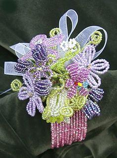 Keepsake beaded flower wristlet corsage in shades of lavender and aubergine.
