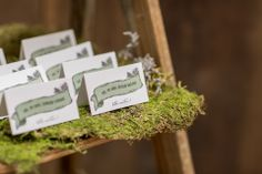 Folded escort cards for a rustic woodland wedding. ©Retrospect Images