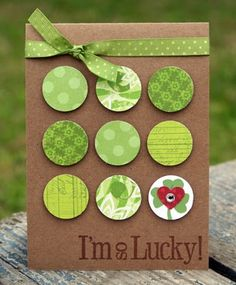 handmade St. Patrick's Day card ... kraft base ... nine patch of circles cut from different  green papers ... one small heart ... green polka-dot ribbon ... lovely!!