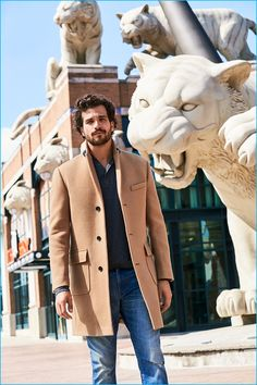 Paul Kelly dons a camel coat with distressed denim jeans from Bonobos'…