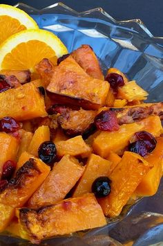 "Air Fryer Orange-Cranberry Butternut Squash with Ginger | ""This colorful side dish uses orange juice, cranberries, and grated fresh ginger to add some extra zing to butternut squash. The air fryer makes preparing dinner convenient, because it leaves your oven available for other duties. Goat cheese crumbles would be a delicious optional topping for this dish."" #thanksgiving #thankgivingrecipes #thanksgivingsidedishes Batch Cooking, Cooking Time, Small Air Fryer, Cranberry Bread, Thanksgiving Side Dishes, Food Reviews, Fresh Ginger, Cranberries, Orange Juice"