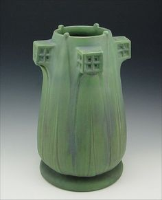 TECO POTTERY VASE DEIGNED BY ORLANDO GIANNINI: Impressed with 167 and the Teco trademark. Green matte glaze. Drilled as for a lamp. 16 1/2'' tall, 11'' dia.