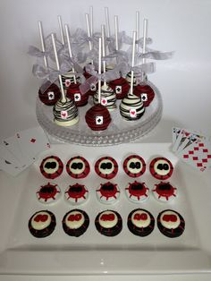 Las Vegas Casino Poker Gambling Theme party dessert tablescape cake pops chocolate covered Oreos poker chips deck of playing cards. $42.00, via Etsy.